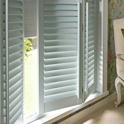 Bifold white window shutters
