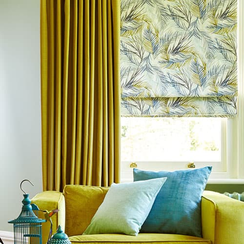 Mustard curtains with patterned roman blinds