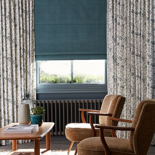 Curtains and roman blinds in a living room