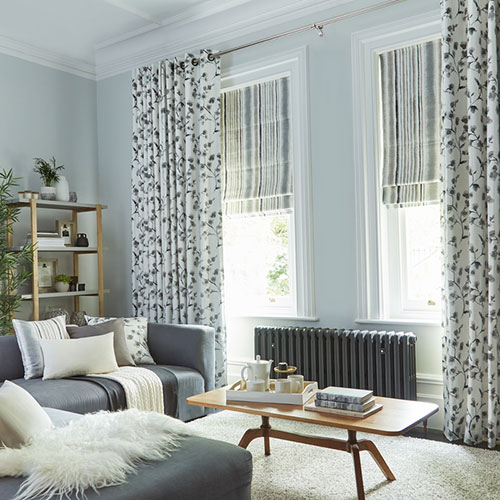 Patterned curtains with roman blinds
